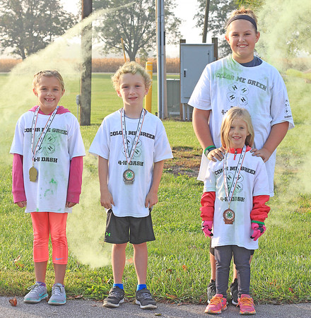submitted photo<br /> KID'S COLOR RUN: From left, Boone County 4-H Color Me Green Kid's Run gold medalist Lilly Pratt, 8, Lebanon; silver medalist Burke Cavins, 7, Jamestown; and bronze medalists Emma Pratt, 11,<br /> Lebanon and June Dimiceli, 5, Lebanon.
