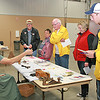 BICENTENNIAL BLOCK PARTY<br /> Elizabeth Pearl | The Lebanon Reporter<br /> PIONEER PUZZLER: Phyllis Myers, coordinator at the Thorntown Heritage Museum, showed a crowd of people a mysterious tool at the Boone County Bicentennial block party on Thursday evening at the Boone County 4-H Fairgrounds. The tool is a holder that people used to hang candles from their Christmas trees. The museum was one of several local organizations that participated in the event, which included a scavenger hunt and a quiz for local government officials on Boone's history.
