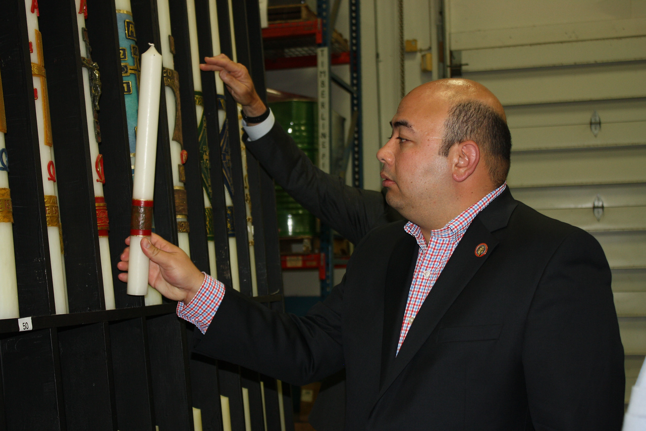 HALEE HEIRONIMUS / GAZETTE Cliff Rosenberger, speaker of the Ohio House of Representatives, looks at church candles that are manufactured at A.I. Root Candles, 623 Liberty St., Medina. Rosenberger took a tour of the A.I. Root Candles warehouse Monday afternoon.