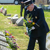 Eric Bonzar—The Morning Journal<br /> Amherst Firefighter Jeff Shamhart places flowers at the grave of Ludwig Hadadi, one of 27 men and women who lost their lives during the Amherst train wreck of 1916. People gathered at the Amherst Sandstone Village and Crownhill Cemetery for a memorial event commemorating the 100th anniversary of the wreck, March 29, 2016. Hadadi--who went unidentified until recently--is buried beside four others whose identities are still unconfirmed.