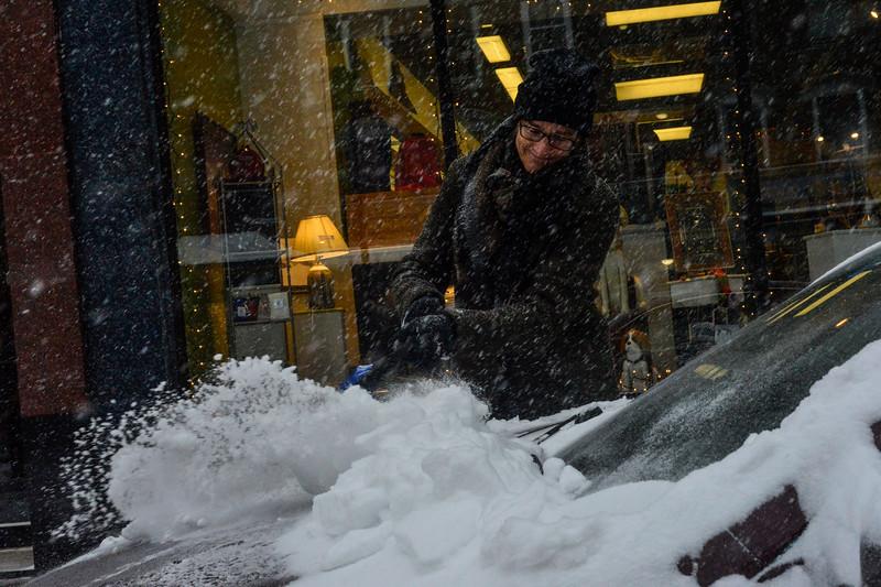 KRISTOPHER RADDER - BRATTLEBORO REFORMER<br /> Gaye Symington, of Jericho, Vt., brushes the snow off her car on Main Street, in Brattleboro, Vt., before driving off to Bennington, Vt., during the winter storm on Thursday, Jan. 4, 2018.