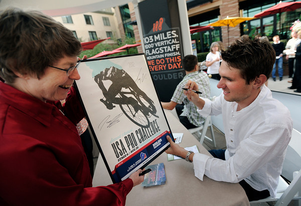 "C.J. Snyder, of Westminster, left, laughs as Olympic cyclist Tejay Van Garderen signs her USA Pro Challenge poster on Thursday, Aug. 16, at the St. Julien Hotel and Spa in Boulder. For more photos and video of the event go to  <a href=""http://www.dailycamera.com"">http://www.dailycamera.com</a><br /> Jeremy Papasso/ Camera"