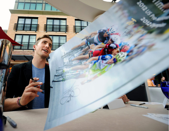 """Taylor Phinney talks with a fan after autographing a poster on Thursday, Aug. 16, at the St. Julien Hotel and Spa in Boulder. For more photos and video of the event go to  <a href=""""http://www.dailycamera.com"""">http://www.dailycamera.com</a><br /> Jeremy Papasso/ Camera"""