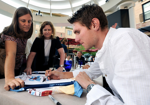 "Olympic cyclist Tejay Van Garderen autographs a race shirt for Mary Bush, left, and Roylene McNeal on Thursday, Aug. 16, at the St. Julien Hotel and Spa in Boulder. For more photos and video of the event go to  <a href=""http://www.dailycamera.com"">http://www.dailycamera.com</a><br /> Jeremy Papasso/ Camera"