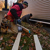 KRISTOPHER RADDER — BRATTLEBORO REFORMER<br /> Dwight Holmez, from Holmez Construction, prepares a few boards to mount to the house so the crane won't damage the unit during a move on Wednesday, Nov. 13, 2019.