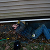 KRISTOPHER RADDER — BRATTLEBORO REFORMER<br /> Dave Renaud, from Renaud Brothers, loops a cable through a hole that was cut into the house so it can be lifted on Wednesday, Nov. 13, 2019.
