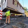 KRISTOPHER RADDER — BRATTLEBORO REFORMER<br /> Joe Reynolds helps navigates the house onto a flatbed truck so it can be transported from the Windham Regional Career Center to the Brattleboro Country Club on Wednesday, Nov. 13, 2019.