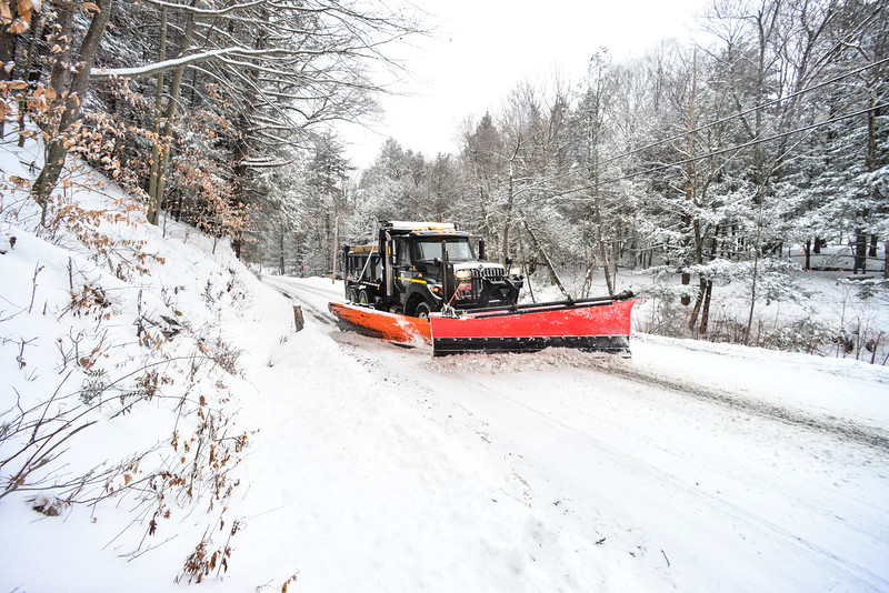 KRISTOPHER RADDER - BRATTLEBORO REFORMER<br /> Rick Gilbeau, a heavy equipment operator for the town of Brattleboro's Department of Public Works, clears the snow off Hinesburg Road on Monday, Dec. 12, 2016.