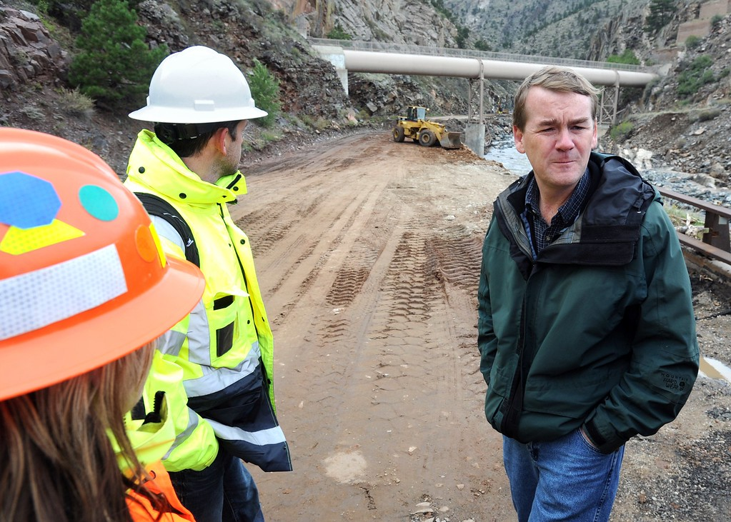 . Sen. Michael Bennet, right, checks out the flood damage on U.S. 34 Friday, October 6, 2013 at the mouth of the Big Thompson Canyon west of Loveland as CDOT crews work on the road. (Photo by Jenny Sparks/Loveland Reporter-Herald)