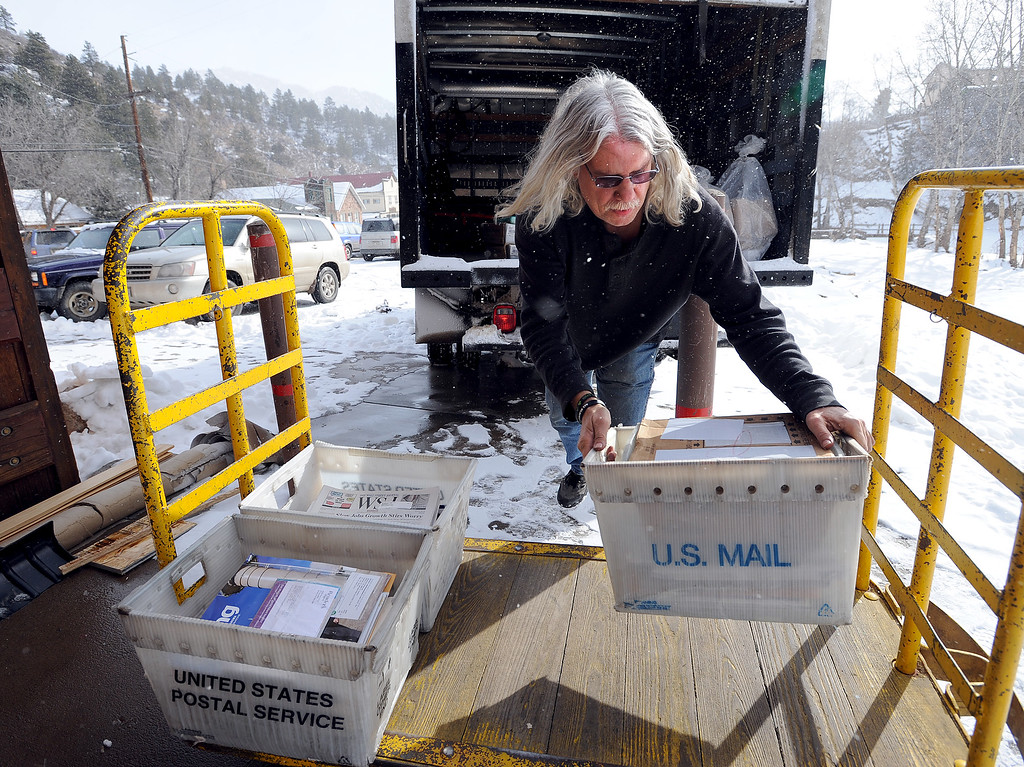 . Tom DeSantis delivers the first mail to Jamestown since the flood. The Jamestown Post Office opened Saturday for the first time since after the flood.  For a video and more photos of the post office, go to www.dailycamera.com.  Cliff Grassmick / February 8, 2014