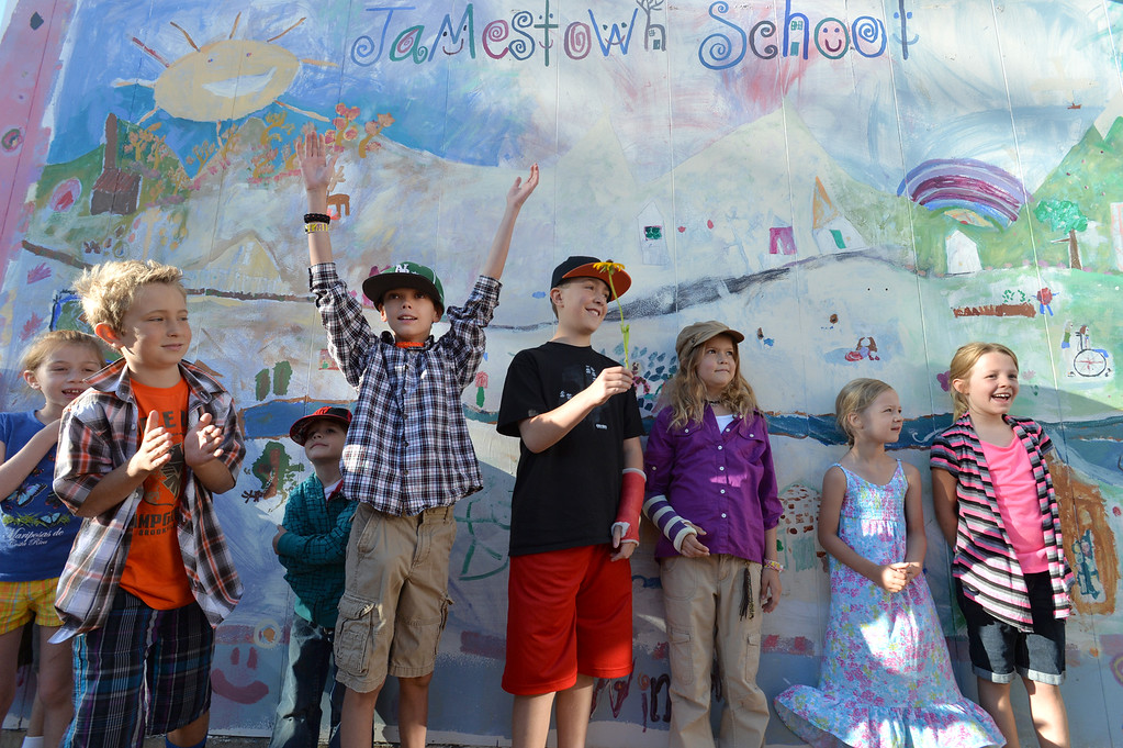 . Mason Bennink, center, raises his arms as the students of Jamestown Elementary School are ready for the first day of school. The school was closed after the September 2013 flood because the roads leading up to the school were washed out. August 21, 2014 Photo/ David R. Jennings