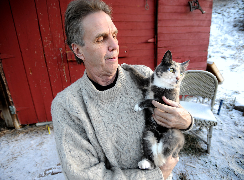 . New owner, Louis Maurer, holds Shadow the cat.  Shadow the cat belonged to the late Joey Howlett. After Howlett was killed in the flood, the cat went missing, and for 40 days was presumed missing. Until it turned up again, with a compound fracture of the left hind leg. For a video with Louis Maurer, go to www.dailycamera.com.  Cliff Grassmick / December 22, 2013