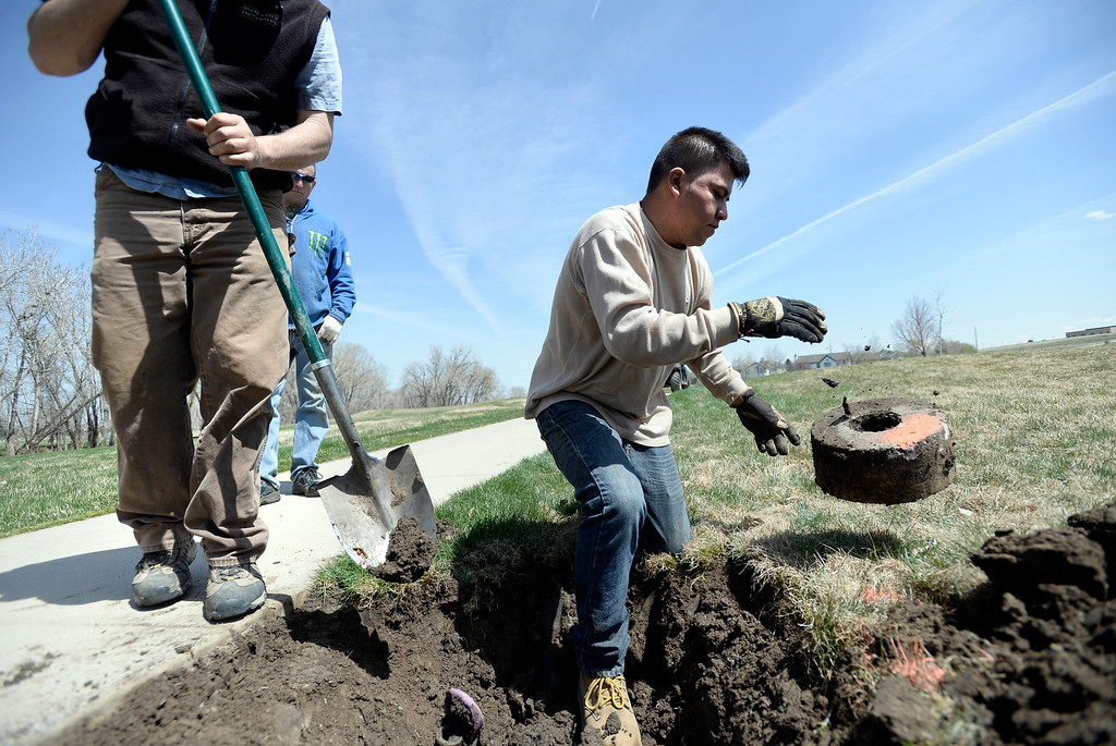 . Jerardo Garrido, of Landscape Unlimited, at right, removes pieces of a sprinkler head damaged by the flood at the Coal Creek Golf Course on Thursday, April 17, in Louisville. For more photos of the flood damaged course go to www.dailycamera.com Jeremy Papasso/ Camera