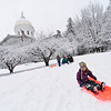 KRISTOPHER RADDER — BRATTLEBORO REFORMER<br /> Siobhan Murman, 6, takes to the fresh snow while sliding down a small hill in front of the Vermont Statehouse, in Montpelier, during the first day of the legislative session on Wednesday, Jan. 9, 2019.