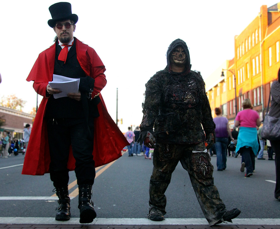 . James Eubanks and Joe Sumy of Pittsfield walk on North St. during the 3rd Thursday evernt held in Pittsfield. The Theme was Monster Mash, guest were invited to come to the block party and wear their scariest costumes. 10/17/13 Holly Pelczynski/Berkshire Eagle Staff