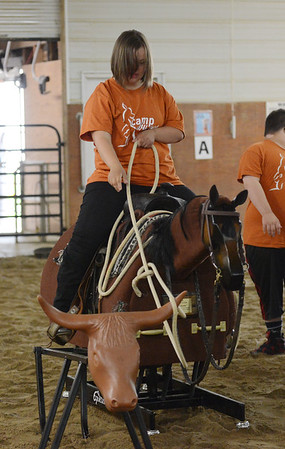 HALEY WARD | THE GOSHEN NEWS <br /> Faith Nickel ropes the cattle during ADEC's summer camp on Friday at Loveway, Inc. Loveway provides people with special needs equine therapy.