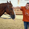 HALEY WARD | THE GOSHEN NEWS <br /> Kris Byrkett pets a horse during ADEC's summer camp on Friday at Loveway, Inc. The summer camp, which has about 40 campers, goes to field trips every Friday like Loveway, go-karts and a petting zoo.