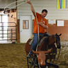 HALEY WARD | THE GOSHEN NEWS <br /> Kris Byrkett makes a lasso to throw on a cattle during ADEC's summer camp on Friday at Loveway, Inc.