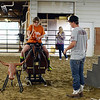 HALEY WARD | THE GOSHEN NEWS <br /> Lexi Tucker tosses a rope onto the cattle as Loveway volunteer Michael Pippenger looks onduring ADEC's summer camp on Friday at Loveway, Inc.