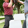 """Andrew DeVries gets a hand lifting one of his bronze sculptures, """"Chariot"""", onto its pedestal.  The work was installed in front of the Lenox Library along with 24 others around downtown as part of the 10th annual Lenox Art Walk.  Lenox, 5/27/10 - Ian Grey"""