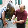 """Andrew DeVries makes a final adjustment to his bronze sculpture named """"Chariot"""".  The work was installed in front of the Lenox Library along with 24 others around downtown as part of the 10th annual Lenox Art Walk.  Lenox, 5/27/10 - Ian Grey"""