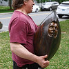 """Andrew DeVries carries one of his bronze sculptures, """"Chariot"""", from the back of his truck to a marble pedestal.  The work was installed in front of the Lenox Library along with 24 others around downtown as part of the 10th annual Lenox Art Walk.  Lenox, 5/27/10 - Ian Grey"""