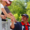 Brian Daubach, coach of the new Pittsfield Colonials, greets fans during Sunday's exhibition game.  Pittsfield, 5/23/10 - Ian Grey