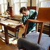 BEN GARVER — THE BERKSHIRE EAGLE<br /> Jeff Holden works on a chair by Asher Israelow. Jamie Israelow and her husband Asher are using a state grant to turn the Country Curtains Co. mill in Housatonic into a collaborative workspace.