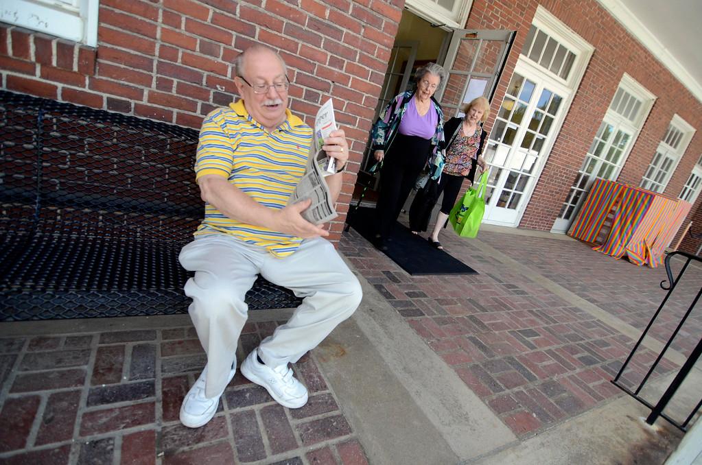 . Harvey Douglas read a newspaper in front of the Dalton CRA, Friday Aug 23, 2013. Ben Garver / Berkshire Eagle Staff
