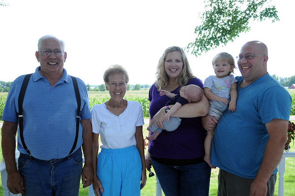 HALEY WARD   THE GOSHEN NEWS<br /> Ray, Kathy, Beth holding 5-week-old Corbin, 18-month-old Hazel and James Eash were named Farm Family of the Year from the Ag Society.