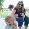 HALEY WARD | THE GOSHEN NEWS<br /> Beth Eash tickles her daughter 18-months-old Hazel while holding 5-weeks-old Corbin Thursday at their Middlebury farm. They were named Farm Family of the Year by the Ag Society.