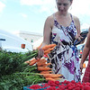 Doreen Fontaine purchased a bunch of carrots during the Fenn Street Farmers Market this Saturday August 10, 2013 in Pittsfield. Photos by Sarah Howard/ Special to The Eagle