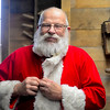 BEN MIKESELL | THE GOSHEN NEWS<br /> Paul Martin of Elkhart puts on his Santa suit Dec. 9 at Linton's Enchanted Gardens. He has been playing the role of Santa Claus for nearly 40 years. His wife Sherry has been helping for 30 years.
