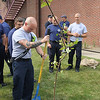 ADAM RANDALL   THE GOSHEN NEWS<br /> Goshen Fire Department Pfc. Camron Haberstich prepares to dig a hole in front of the Goshen Central Fire Station on Third Street where the 9/11 sapling was planted.