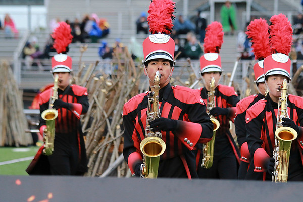 "Stacey Diamond | The Goshen News<br /> Sophomore Kevin, center, plays the tenor saxophone in a section of woodwinds for Goshen's performance of ""Pyromania Saturday."