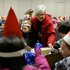BEN MIKESELL | THE GOSHEN NEWS<br /> LaDene Nesbitt, first-grade teacher at West Goshen Elementary, hands out goodie bags for her students to hand out while caroling Wednesday at Greencroft Goshen.