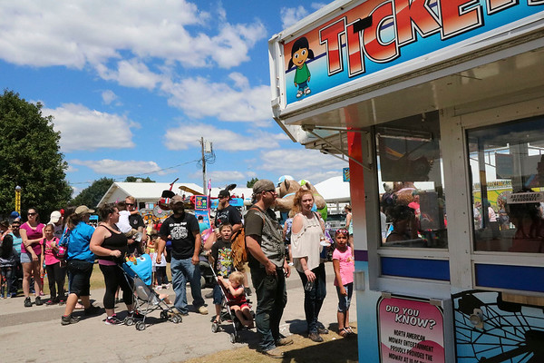 SHEILA SELMAN | THE GOSHEN NEWS<br /> A long line of people wait to buy tickets to the midway rides at the Elkhart County 4-H Fair Saturday.