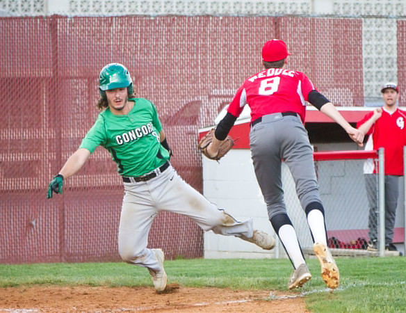 SAM HOUSEHOLDER | THE GOSHEN NEWS<br /> Goshen junior pitcher Andrew Weddle tags out Concord senior Jake Wirt as he tried to cross homeplate during the game Friday.