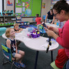 SHERRY VAN ARSDALL | THE GOSHEN NEWS<br /> On  Thursday at Syracuse Elementary School, kindergartner Nora Jensen smiles as her neighbor, Noelle Lindsey, takes a picture to send to Nora's mother.