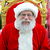 BEN MIKESELL | THE GOSHEN NEWS<br /> Paul Martin of Elkhart has been playing the role of Santa Claus for nearly 40 years. His wife Sherry has been helping for 30.
