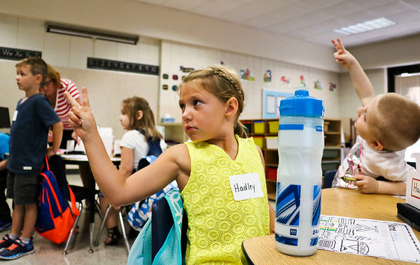 LEANDRA BEABOUT | THE GOSHEN NEWS<br /> Kindergartener Hadley Stafford shows her teach the number two on the first day of school at Ox Bow Elementary School.
