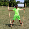 SHERRY VAN ARSDALL | THE GOSHEN NEWS<br /> Jaylen Cook, 10, of Dunlap, tries to keep his balance on wooden stilts during the 50th celebration of Elkhart County Parks at Ox Bow County Park in Dunlap Sunday afternoon.