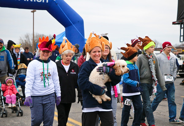 LEANDRA BEABOUT | THE GOSHEN NEWS<br /> Many racers brought their dogs to participate in the Turkey Stampede. Some enjoyed the exercise more than others.
