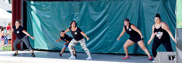 CHRISTINA C LARK | THE GOSHEN NEWS Amy Stebleton, center,  heads up hip-hop routines for National Dance Day with Lashelle Brown, Elkhart, Stebleton's grandaughter Kailea Klingerman,5, Elkhart, Heather Cline, Elkhart, and Graciela Granados, Elkart.
