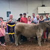 PHOTO CONTRIBUTED<br /> Chandler Gillam's family gathered Tuesday to celebrate his Grand Champion Steer. From left, Brooks and Laura Blosser with Ava, Ezra, and Emmett; Chris Gillam; Collin Deatsman; Brian Deatsman; Zac and Brittney Lechlitner with Charlie; steer show judge Todd Herman; Dick Gillam; Cathy Gillam; Chandler Gillam; and Blake and Kelsey Taylor with Wilson and Evelyn.
