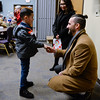 BEN MIKESELL | THE GOSHEN NEWS<br /> Cristian Herrera, first-grader at West Goshen Elementary, Mayor Jeremy Stutsman on Wednesday at Greencroft Goshen. The students made gift bags to be handed out to residents, as part of Stutsman's Year of Goodness initiative. Herrera asked Stutsman if he was the boss of Goshen.