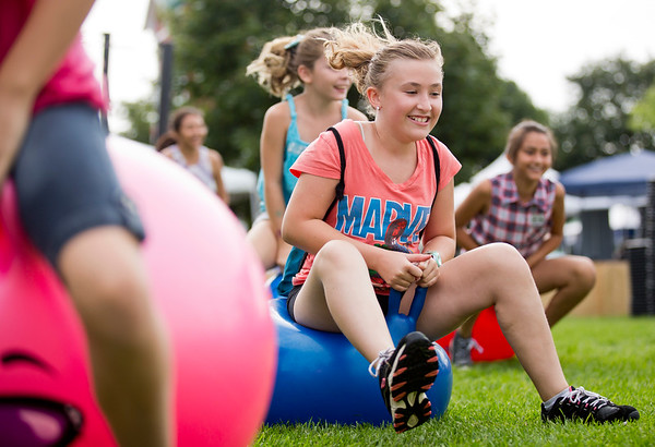 JAY YOUNG | THE GOSHEN NEWS<br /> Ten-year-old Alyssen Weesner, of Goshen, competes in a big bouncy ball race  during Kids' Day at the Elkhart County 4-H Fair Wednesday morning.