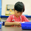 JULIE CROTHERS BEER | THE GOSHEN NEWS<br /> Kindergartner Kiko Wu settles in with a morning activity on her first day of school Wednesday at Nappanee Elementary School.