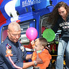 SHEILA SELMAN | THE GOSHEN NEWS<br /> Lucas Sears, 3, Dunlap, is helped off the Memorial Medlight helicopter by flight paramedic Grant Roberts, while mom, Brittany, exits Saturday at Touch A Truck at Faith united Methodist Church near Goshen.