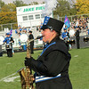 Abby Poff plays her saxaphone at the front edge of Jake Field for the Falcon Marching Pride Saturday.